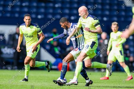 West Bromwich Albion  midfielder Matt Phillips (10) tussles for the ball with Newcastle United midfielder Jonjo Shelvey (8) during the Premier League match between West Bromwich Albion and Newcastle United at The Hawthorns, West Bromwich
