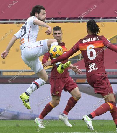 Genoa's Mattia Destro (L) and Roma's Chris Smalling struggle for the ball during the Serie A soccer match Roma vs Genoa at the Olimpico Stadium in Rome, Italy, 07 March 2021.
