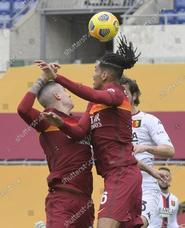 Roma's Gianluca Mancini (L) and teammate Chris Smalling jump for the ball during the Italian Serie A soccer match Roma vs Genoa at the Olimpico Stadium in Rome, Italy, 07 March 2021.