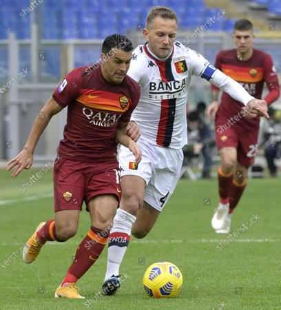 Roma's Pedro (L) and Genoa's Valon Behrami struggle for the ball during the Italian Serie A soccer match Roma vs Genoa at the Olimpico Stadium in Rome, Italy, 07 March 2021.