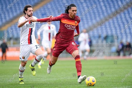 Mattia Destro of Genoa CFC and Chris Smalling of AS Roma compete for the ball during the Serie A match between AS Roma and Genoa CFC at Stadio Olimpico, Rome, Italy on 7 March 2021.
