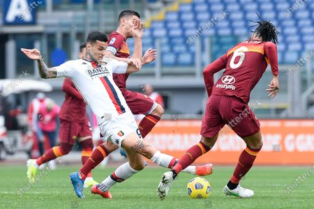 Gianluca Scamacca of Genoa CFC and Chris Smalling of AS Roma compete for the ball during the Serie A match between AS Roma and Genoa CFC at Stadio Olimpico, Rome, Italy on 7 March 2021.