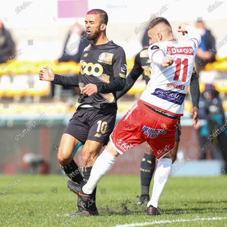 Stock Picture of Standard's Mehdi Carcela and Mouscron's Dimitri Mohamed pictured in action during a soccer match between Royal Excel Mouscron and Standard Liege, Sunday 07 March 2021 in Mouscron, on day 29 of the 'Jupiler Pro League' first division of the Belgian championship.