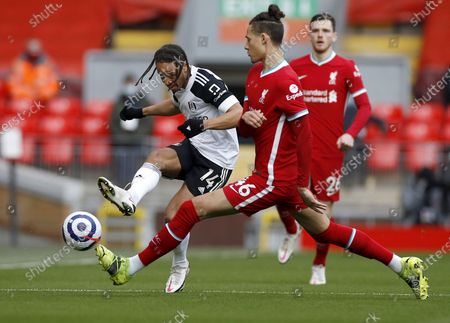 Rhys Williams (R) of Liverpool in action against Bobby Decordova-Reid (L) of Fulham during the English Premier League soccer match between Liverpool FC and Fulham FC in Liverpool, Britain, 07 March 2021.