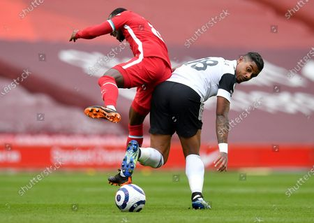 Naby Keita (L) of Liverpool in action against Mario Lemina (R) of Fulham during the English Premier League soccer match between Liverpool FC and Fulham FC in Liverpool, Britain, 07 March 2021.