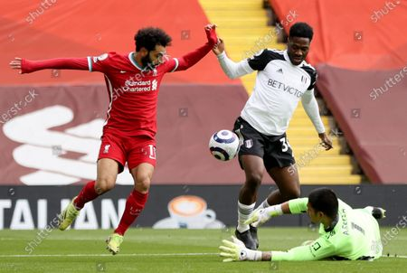 Mohamed Salah (L) of Liverpool in action against goalkepeer Alphonse Areola (R) of Fulham during the English Premier League soccer match between Liverpool FC and Fulham FC in Liverpool, Britain, 07 March 2021.