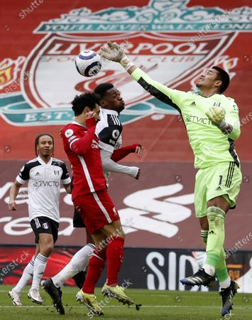 Goalkepeer Alphonse Areola (R) of Fulham in action against Mohamed Salah (L) of Liverpool during the English Premier League soccer match between Liverpool FC and Fulham FC in Liverpool, Britain, 07 March 2021.