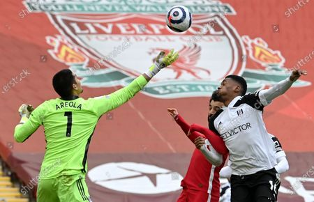 Goalkepeer Alphonse Areola (L) of Fulham in action against Mohamed Salah (C) of Liverpool during the English Premier League soccer match between Liverpool FC and Fulham FC in Liverpool, Britain, 07 March 2021.