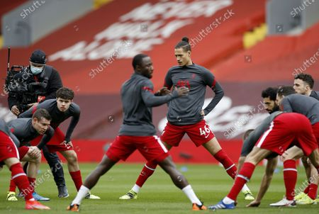 Rhys Williams (C-R) and teammates of Liverpool warm up prior to the English Premier League soccer match between Liverpool FC and Fulham FC in Liverpool, Britain, 07 March 2021.