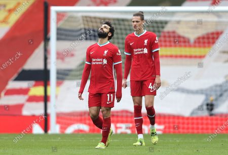 Liverpool's Mohamed Salah and Liverpool's Rhys Williams react after Fulham's Mario Lemina scored his side's first goal during the English Premier League soccer match between Liverpool and Fulham at Anfield stadium in Liverpool, England