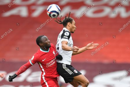 Liverpool's Naby Keita, left, and Fulham's Bobby Decordova-Reid challenge for the ball during the English Premier League soccer match between Liverpool and Fulham at Anfield stadium in Liverpool, England