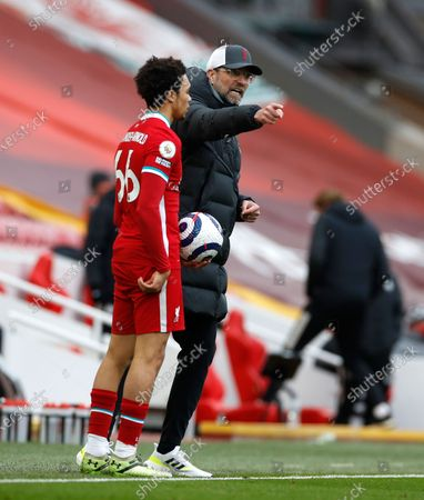 Liverpool's manager Jurgen Klopp speaks to his player Trent Alexander-Arnold during the English Premier League soccer match between Liverpool and Fulham at Anfield stadium in Liverpool, England