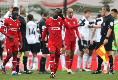 Liverpool's Naby Keita reacts after the English Premier League soccer match between Liverpool and Fulham at Anfield stadium in Liverpool, England