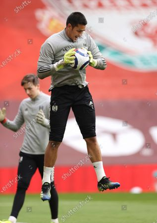 Fulham's goalkeeper Alphonse Areola warms up prior to the English Premier League soccer match between Liverpool and Fulham at Anfield stadium in Liverpool, England