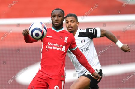 Liverpool's Naby Keita, left, and Fulham's Mario Lemina in action during the English Premier League soccer match between Liverpool and Fulham at Anfield stadium in Liverpool, England