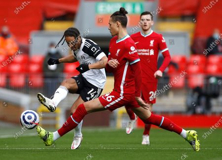 Fulham's Bobby Decordova-Reid kicks the ball ahead of Liverpool's Rhys Williams during the English Premier League soccer match between Liverpool and Fulham at Anfield stadium in Liverpool, England