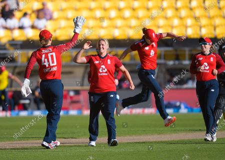 England's Katherine Brunt celebrates dismissing Sophie Devine during the 3rd international women's T20 cricket match between the New Zealand White Ferns and England at Sky Stadium in Wellington, New Zealand