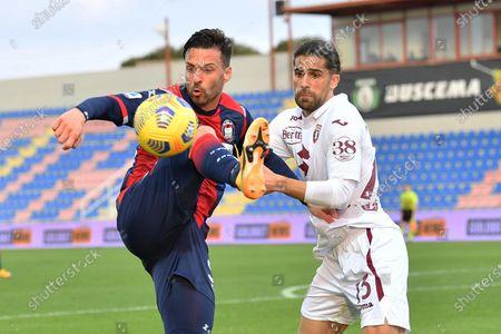 Crotone's Samuel Di Carmine (L) and Torino's Ricardo Rodriguez (R) in action during the Italian Serie A soccer match between FC Crotone and Torino FC at Ezio Scida stadium in Crotone, Italy, 07 March 2021.