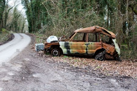 A  dumped and burnt out Land Rover Discovery on the  lane  on the edge of Sydmonton Court Esate, the country home of Sir Andrew Lloyd Webber which is now encouraging other fly tippers.