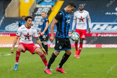 Stock Photo of Essevee's Omar Govea and Club's Nabil Dirar fight for the ball during a soccer match between Club Brugge KV and SV Zulte Waregem, Sunday 07 March 2021 in Brugge, on day 29 of the 'Jupiler Pro League' first division of the Belgian championship.