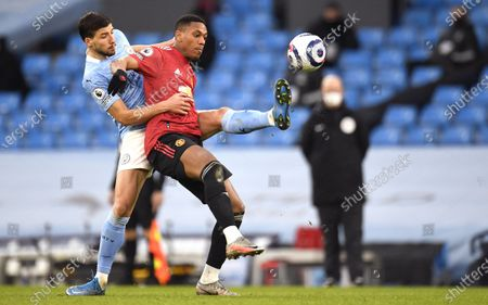 Ruben Dias (L) of Manchester City in action against Anthony Martial of Manchester United during the English Premier League soccer match between Manchester City and Manchester United in Manchester, Britain, 07 March 2021.
