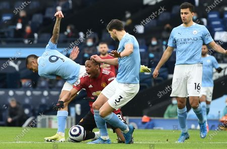 Gabriel Jesus (L) of Manchester City fouls Anthony Martial of Manchester United during the English Premier League soccer match between Manchester City and Manchester United in Manchester, Britain, 07 March 2021.