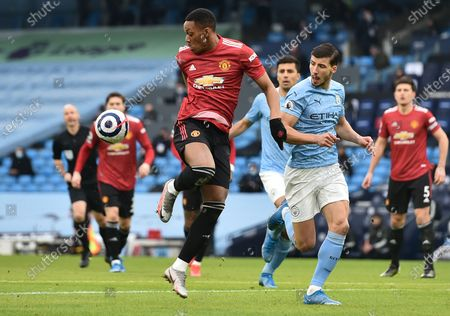 Ruben Dias (R) of Manchester City in action against Anthony Martial of Manchester United during the English Premier League soccer match between Manchester City and Manchester United in Manchester, Britain, 07 March 2021.