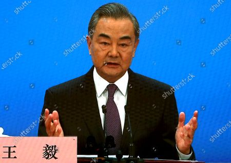 """Stock Image of Chinese State Councilor and Foreign Minister Wang Yi speaks on a television screen (due to pandemic) at his annual news conference during the country's parliamentary sessions.  Wang urged the U.S. to remove """"unreasonable"""" curbs on cooperation as soon as possible and work together on mutual interests like climate change.  Last week U.S. Joe Biden singled out China as a """"growing rivalry"""" and serious challenge facing the U.S.."""