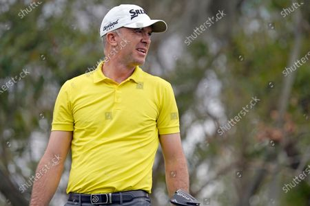 Martin Laird, of Scotland, walks off the third tee box after his shot during the third round of the Arnold Palmer Invitational golf tournament, in Orlando, Fla