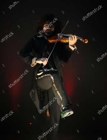 Stock Photo of Ara Malikian plays his violin during the performance. Armenian-Spanish violinist, Ara Malikian performs at Cervantes theatre in his new musical show 'Le petite garage', adapted from restrictions and safety measures caused by coronavirus pandemic.