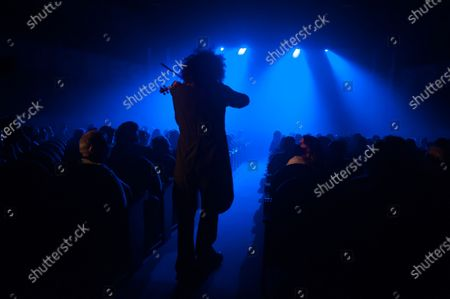 Stock Image of Ara Malikian plays his violin during the performance. Armenian-Spanish violinist, Ara Malikian performs at Cervantes theatre in his new musical show 'Le petite garage', adapted from restrictions and safety measures caused by coronavirus pandemic.