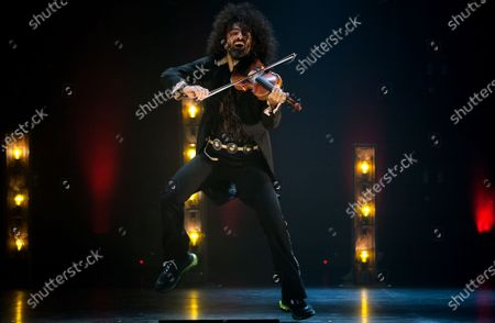 Stock Picture of Ara Malikian plays his violin during the performance. Armenian-Spanish violinist, Ara Malikian performs at Cervantes theatre in his new musical show 'Le petite garage', adapted from restrictions and safety measures caused by coronavirus pandemic.