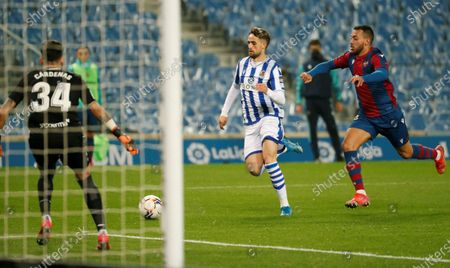 Real Sociedad's Belgian winger Adnan Januzaj (C) duels for the ball with Levante's Portuguese defender Ruben Vezo (R) during the Spanish LaLiga soccer match between Real Sociedad and Levante UD at Reale Arena stadium in San Sebastian, Basque Country, Spain, 07 March 2021.
