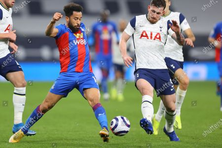 Tottenham's Pierre-Emile Hojbjerg, right, fights for the ball with Crystal Palace's Andros Townsend during the English Premier League soccer match between Tottenham Hotspur and Crystal Palace at the Tottenham Hotspur Stadium in London