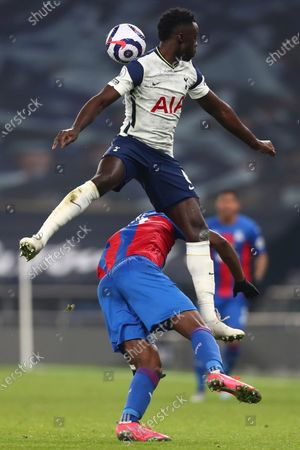 Tottenham's Davinson Sanchez, jumps on top of Crystal Palace's Christian Benteke during the English Premier League soccer match between Tottenham Hotspur and Crystal Palace at the Tottenham Hotspur Stadium in London