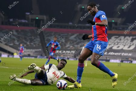 Crystal Palace's Jean-Philippe Mateta, right, is challenged by Tottenham's Davinson Sanchez during the English Premier League soccer match between Tottenham Hotspur and Crystal Palace at the Tottenham Hotspur Stadium in London