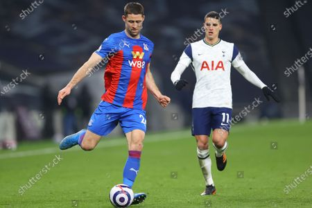 Crystal Palace's Gary Cahill, left, is challenged by Tottenham's Erik Lamela during the English Premier League soccer match between Tottenham Hotspur and Crystal Palace at the Tottenham Hotspur Stadium in London