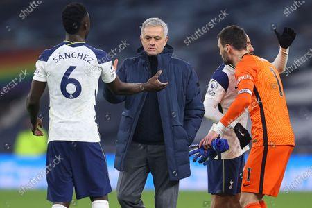 Tottenham's manager Jose Mourinho, center, congratulates Tottenham's Davinson Sanchez at the end of the English Premier League soccer match between Tottenham Hotspur and Crystal Palace at the Tottenham Hotspur Stadium in London