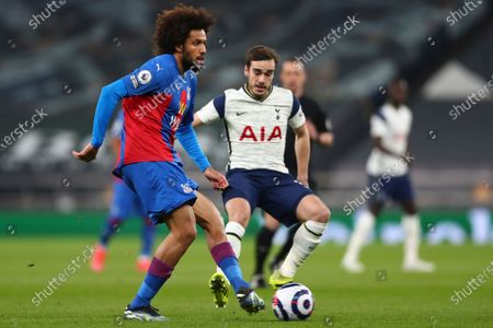 Crystal Palace's Jairo Riedewald, left, is challenged by Tottenham's Harry Winks during the English Premier League soccer match between Tottenham Hotspur and Crystal Palace at the Tottenham Hotspur Stadium in London