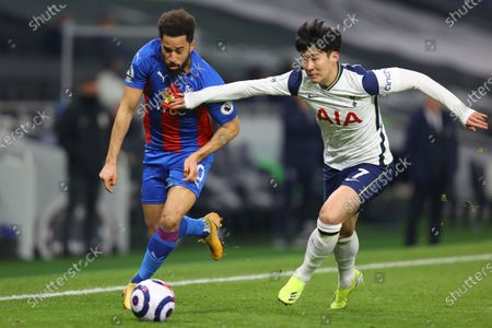Crystal Palace's Andros Townsend, left, is challenged by Tottenham's Son Heung-min during the English Premier League soccer match between Tottenham Hotspur and Crystal Palace at the Tottenham Hotspur Stadium in London