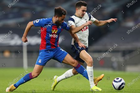 Crystal Palace's Andros Townsend, left, is challenged by Tottenham's Sergio Reguilon during the English Premier League soccer match between Tottenham Hotspur and Crystal Palace at the Tottenham Hotspur Stadium in London