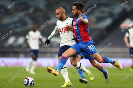 Crystal Palace's Andros Townsend, right, fights for the ball with Tottenham's Lucas Moura during the English Premier League soccer match between Tottenham Hotspur and Crystal Palace at the Tottenham Hotspur Stadium in London