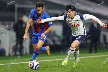 Stock Image of Son Heung-min (R) of Tottenham in action against Andros Townsend (L) of Palace during the English Premier League soccer match between Tottenham Hotspur and Crystal Palace in London, Britain, 07 March 2021.