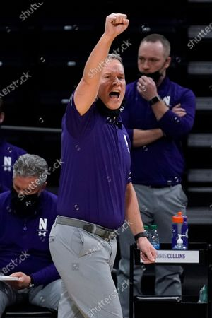 Northwestern head coach Chris Collins calls his team during the second half of an NCAA college basketball game against Nebraska in Evanston, Ill