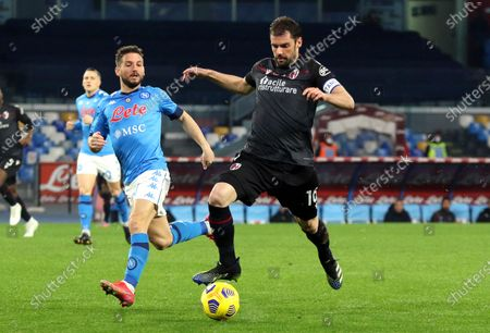 Napoli's Dries Mertens (L) in action against Bologna's Andrea Poli (R) during the Italian Serie A soccer match between SSC Napoli and Bologna FC at Diego Armando Maradona stadium in Naples, Italy, 07 March 2021.