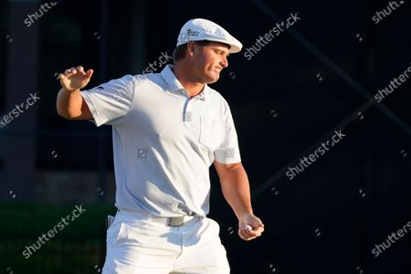 Bryson DeChambeau reacts after missing a putt on the 16th green during the final round of the Arnold Palmer Invitational golf tournament, in Orlando, Fla