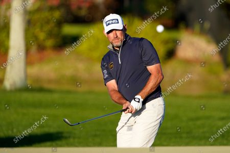 Lee Westwood, of England, hits a shot to the 15th green during the final round of the Arnold Palmer Invitational golf tournament, in Orlando, Fla
