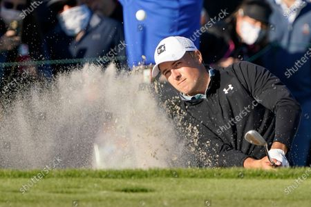 Jordan Spieth hits a shot from the sand trap on the 15th hole during the final round of the Arnold Palmer Invitational golf tournament, in Orlando, Fla
