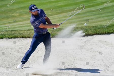 Tyrell Hatton hits a shot from the sand trap on the sixth hole during the final round of the Arnold Palmer Invitational golf tournament, in Orlando, Fla