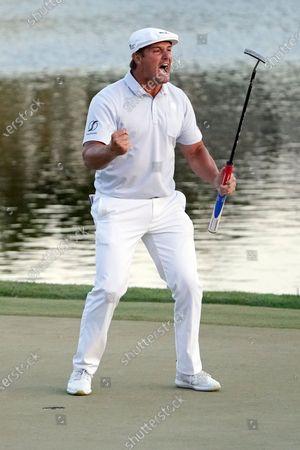 Bryson DeChambeau celebrates after sinking a putt to win the Arnold Palmer Invitational golf tournament, in Orlando, Fla